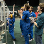 An excited FIRST Robotics Team celebrates at a tournament. Photo credit: Danny Levenson